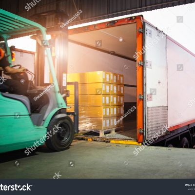 stock-photo-forklift-tractor-loading-package-boxes-into-cargo-container-trailertruck-parked-loading-at-dock-1936041751